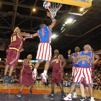 Harlem Globetrotter player making a basket during a basketball game.