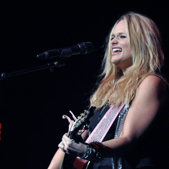 Miranda Lambert rocking and singing into the microphone.