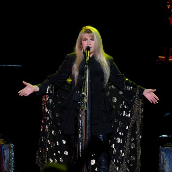 Stevie Nicks singing on stage during a concert.